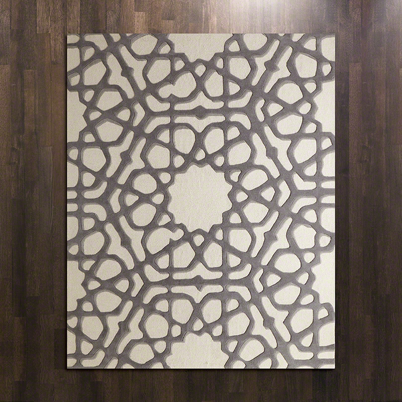 Rose Window Rug - Inspired by Gothic stained glass windows, this graphic and harmonious rug is 100% hand tufted wool. It has a loop pile neutral base with a cut pile color decoration in two tones and two levels, giving it extra dimension and interest. Four sizes: 5'x8', 6'x9', 8'x10', and 9'x12'.