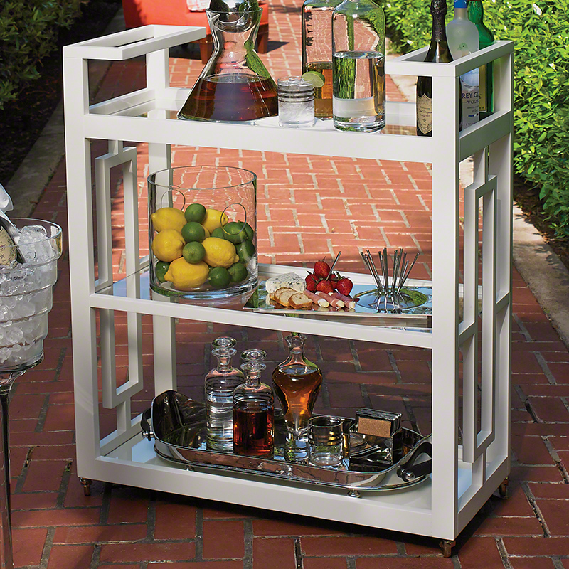 Grid Block Cart - Reminiscent of the entertainment of the mid-century, the Grid Block Bar Cart captures the geometric architecture and furniture of the time period. The matte white lacquer finish brings a sophisticated elegance to this modern design. Features integrated handles, three tiers of removable glass shelves, and fully rotational cast brass wheels. White or Black 36