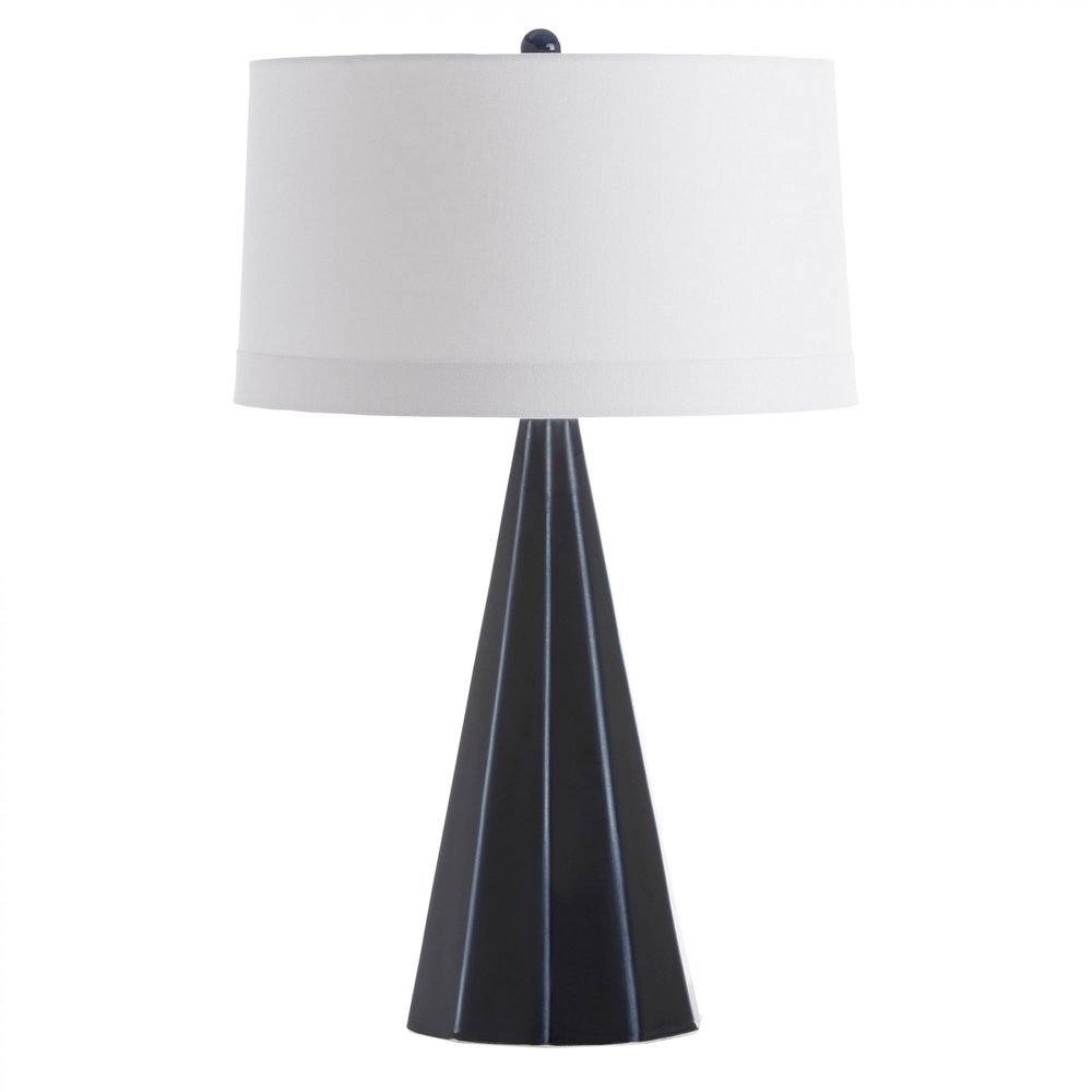 Gorman Lamp - A familiar form with an unexpected twist, the Gorman Lamp marries a geometric cone shape with multiple facets and angles. The porcelain lamp's navy finish highlights its ridges and details. Contrasted by its white linen drum shade and matching finial. Finish may vary.Overall: 18