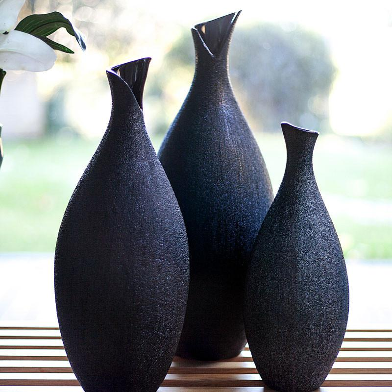 Obsidia Vases - The texture of these decorative vases resembles glossy black Obsidian stones. They are shaped with classic softly curved lines that will complement any decor. Sm: 13
