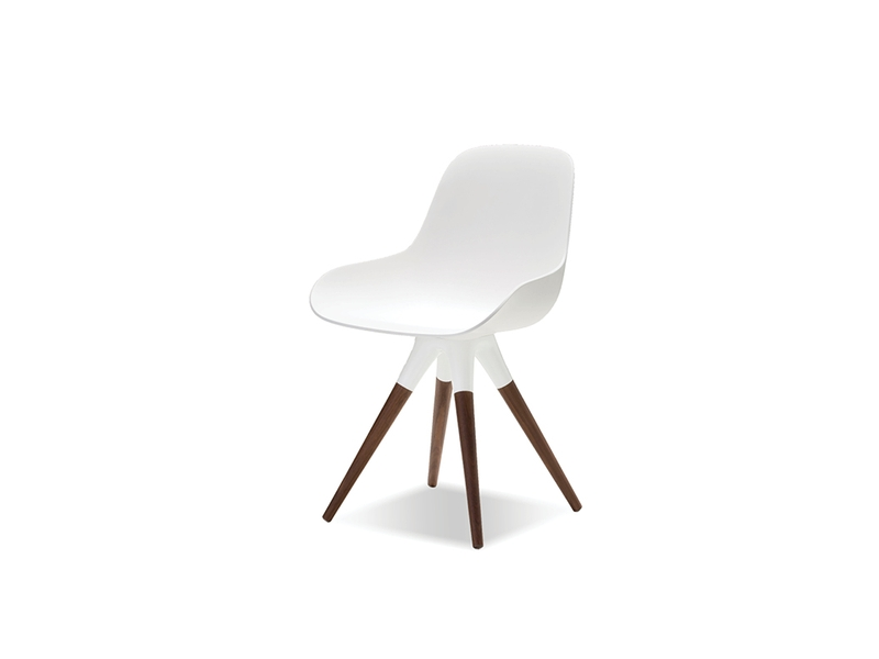 Iztuzu Chair - The Iztuzu chair is constructed much the same as the table with the addition of fibreglass to give that chair its beatiful curves and clean aesthetics. The legs are made from a solid black walnut wood