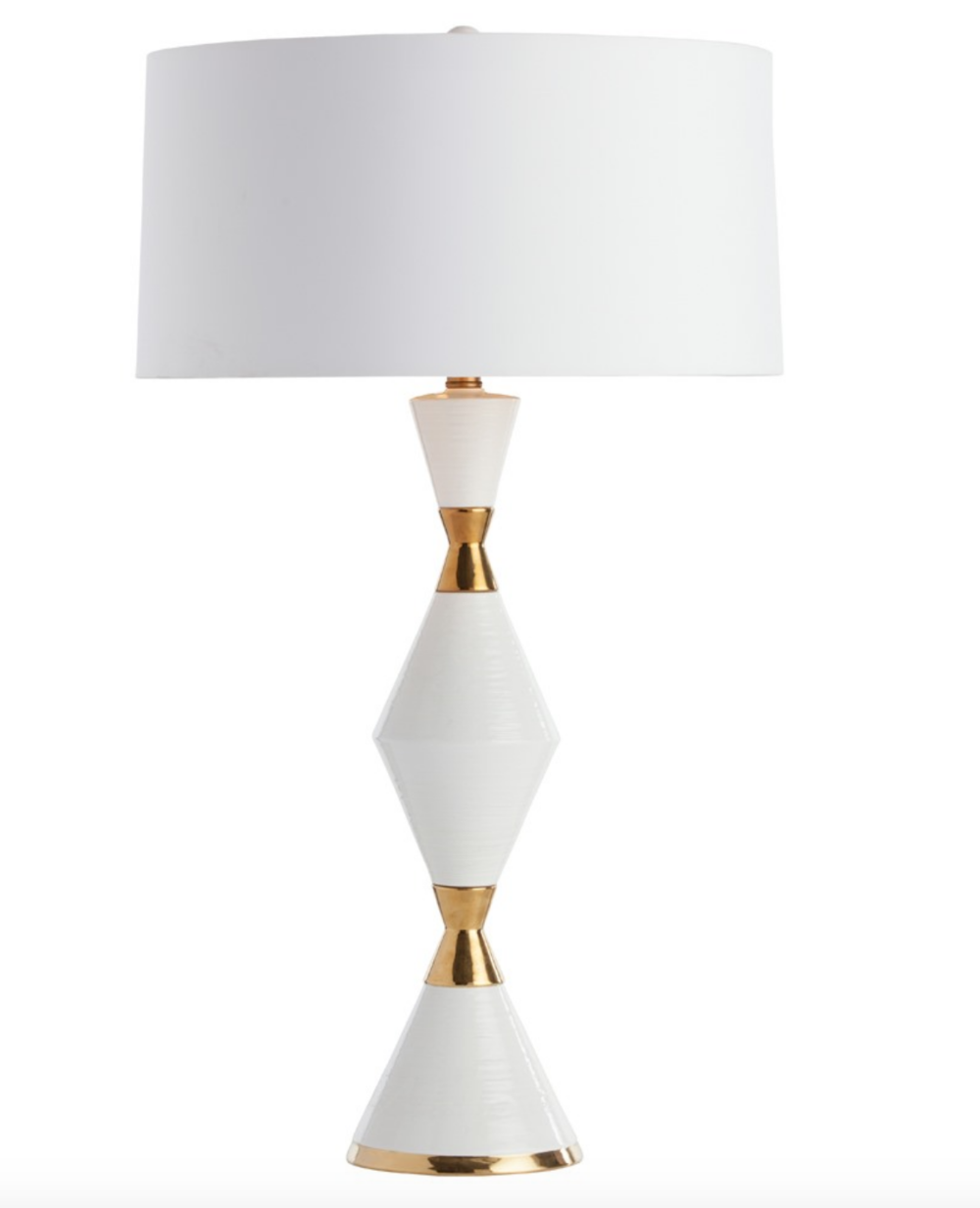 Adair Lamp - The gold cinch waist detail on this striking white gloss ceramic lamp, makes it an ideal statement piece. The white microfiber drum shade is lined in gold foil to continue the theme and up the glamour quotient. Matching ceramic finial.Overall: 18