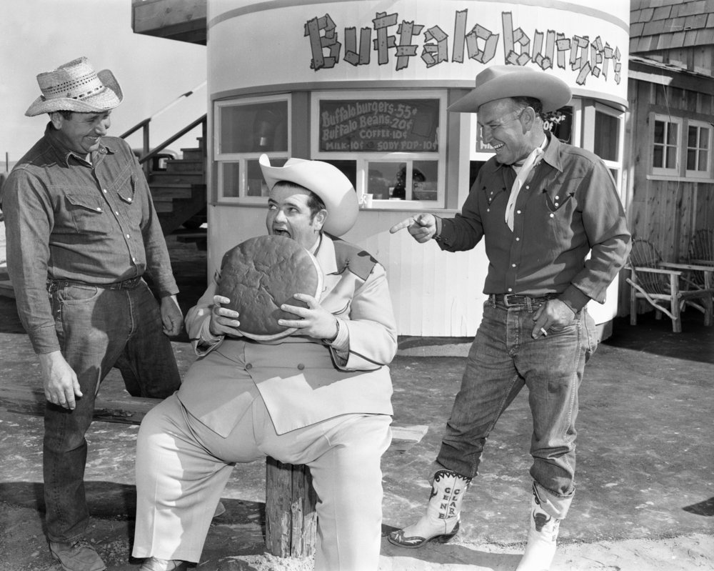 Radio DJ Texas Tiny eats a buffalo burger by OC Archives