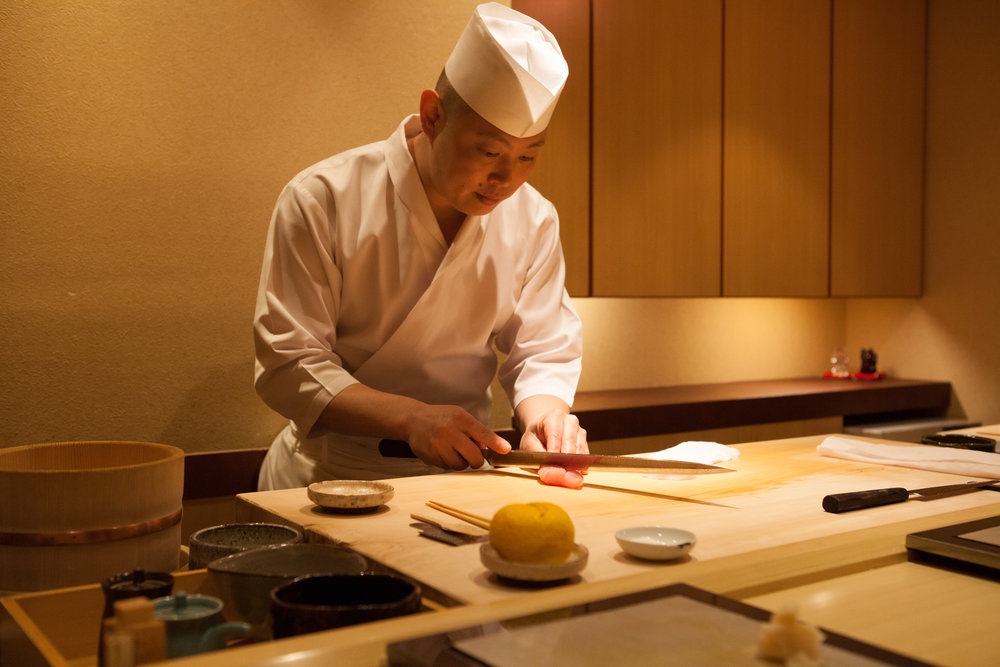 Head Chef cutting some delicious sushi!