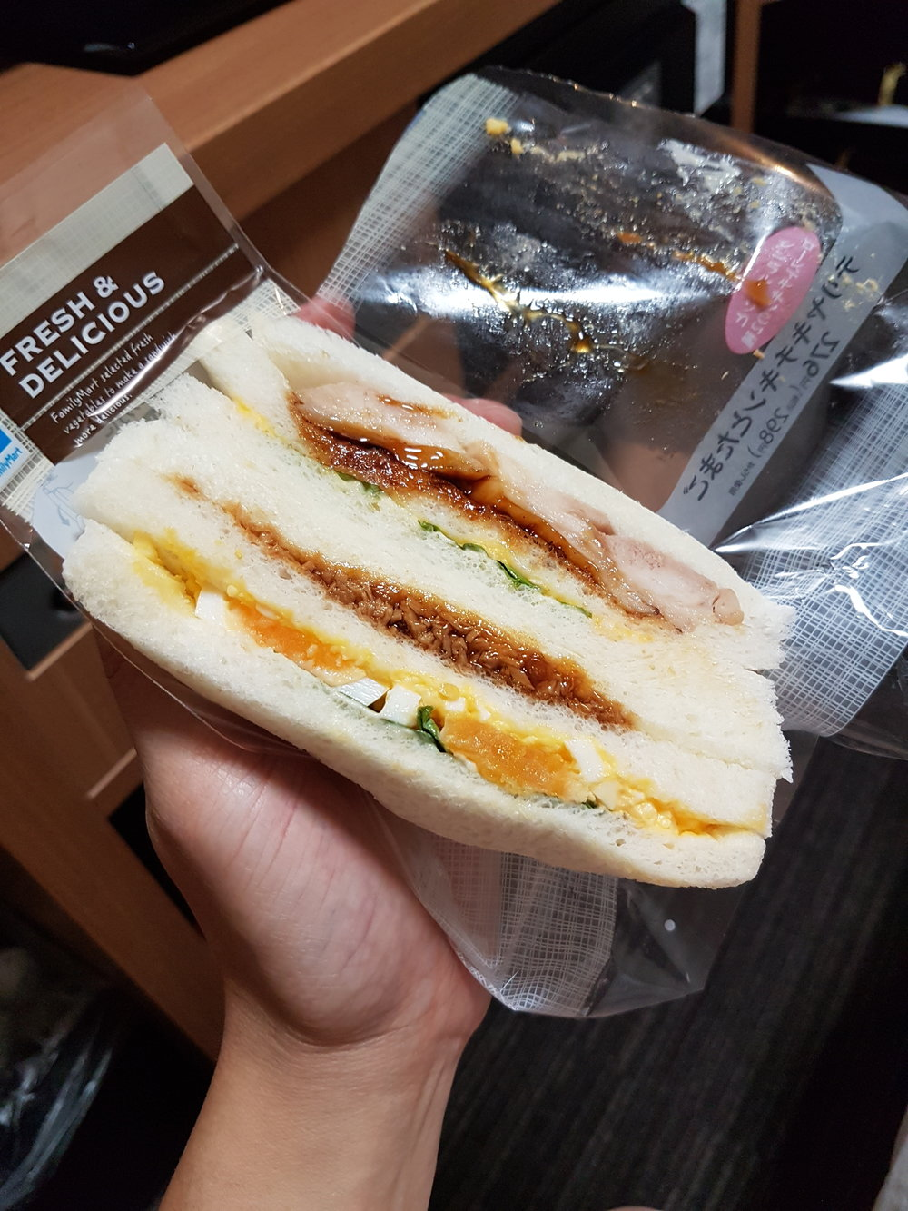 Family Mart's sandwiches... egg salad + chicken teriyaki and ground pork!