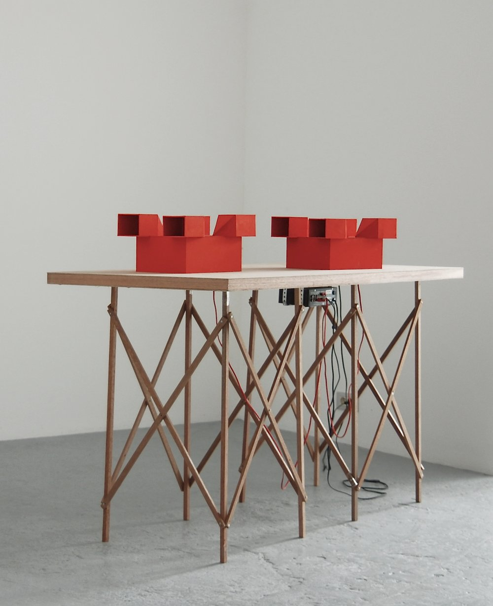 Jean-Pascal Flavien,  Discussion,  2007, table, cardboard models, speakers, ipod, sound, 105 x 150 x 70 cm