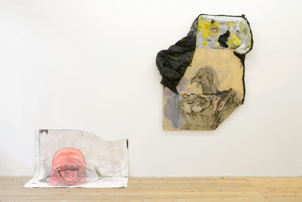 left : Henrik Olai Kaarstein,  Dzhokhar Rose , 2013, acrylic paint, iridescent medium, vinyl paint, charcoal, silicone, oil pastels, cardboard, (Unfolded) 141 x 114 cm  right : Henrik Olai Kaarstein,  Night, Fall , 2013, acrylic paint, iridescent medium, oil pastels, charcoal, acetone, office table, sleeping bag, 191 x 134 cm