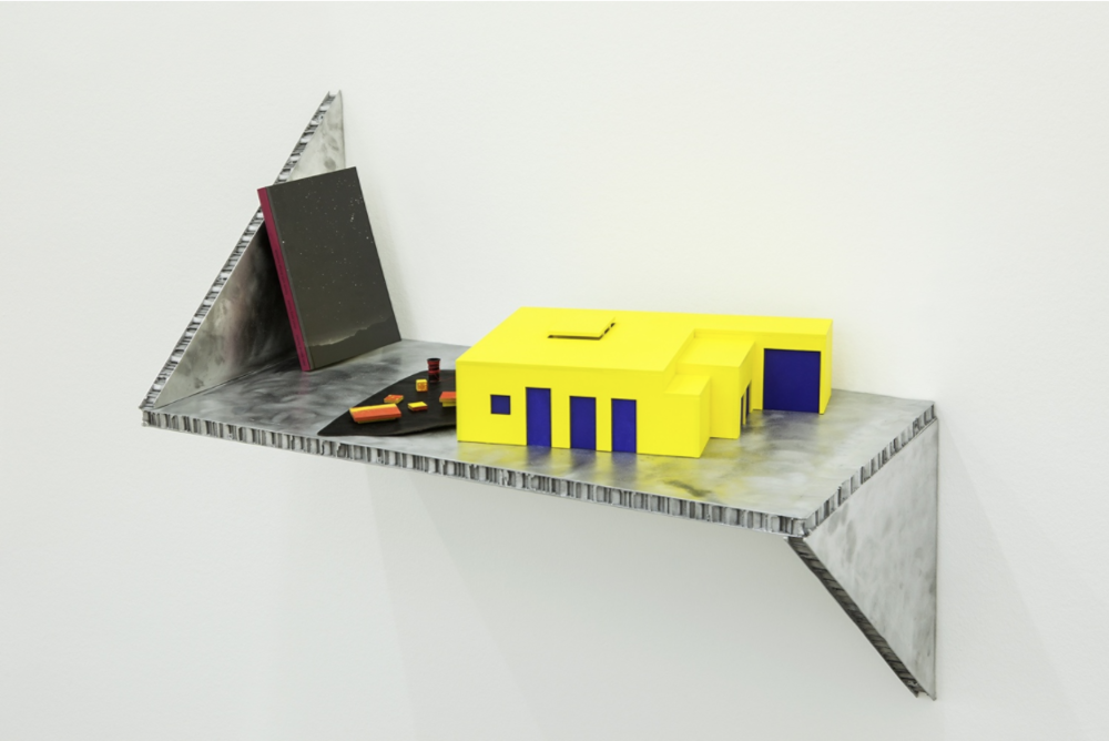Short story house: House with things outside,   2014,painted wood, leather, yarn spool (house model), offset on paper (book), cast aluminum (shelf),8 x 45 x 24 cm (house model), 21 x 13,15 x 1,2 cm (book), 51 x 69 x 35 cm (shelf). Photo: © Andrea Rossetti