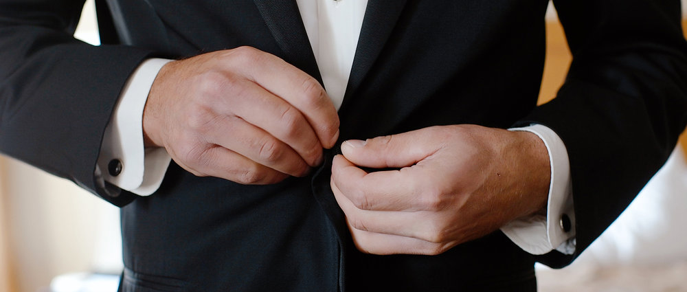 groom-getting-ready-drury-wichita.jpeg