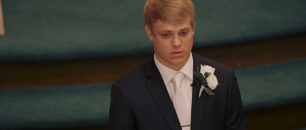 groom-crying-when-seeing-bride