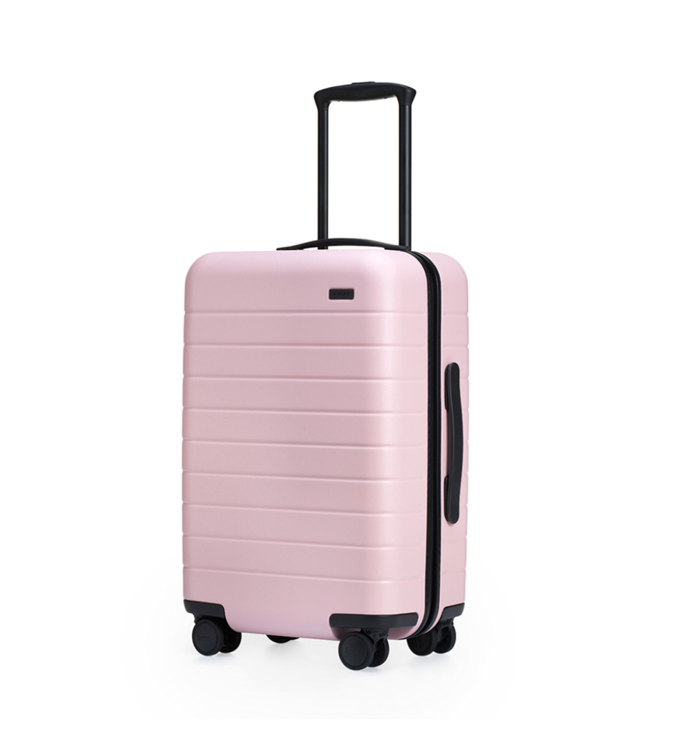 THE AWAY CARRY-ON - Know of a business owner who is ALWAYS on the go? This carry-on by Away is the perfect piece of luggage for the girlboss who has places to be! Plus, it has a built in battery for you to charge your devices until you reach your next destination!