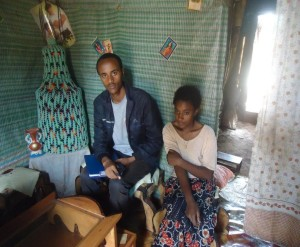 A project coordinator visits a young student at her foster home