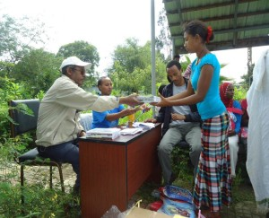 Partners distribute school  books and writing supplies
