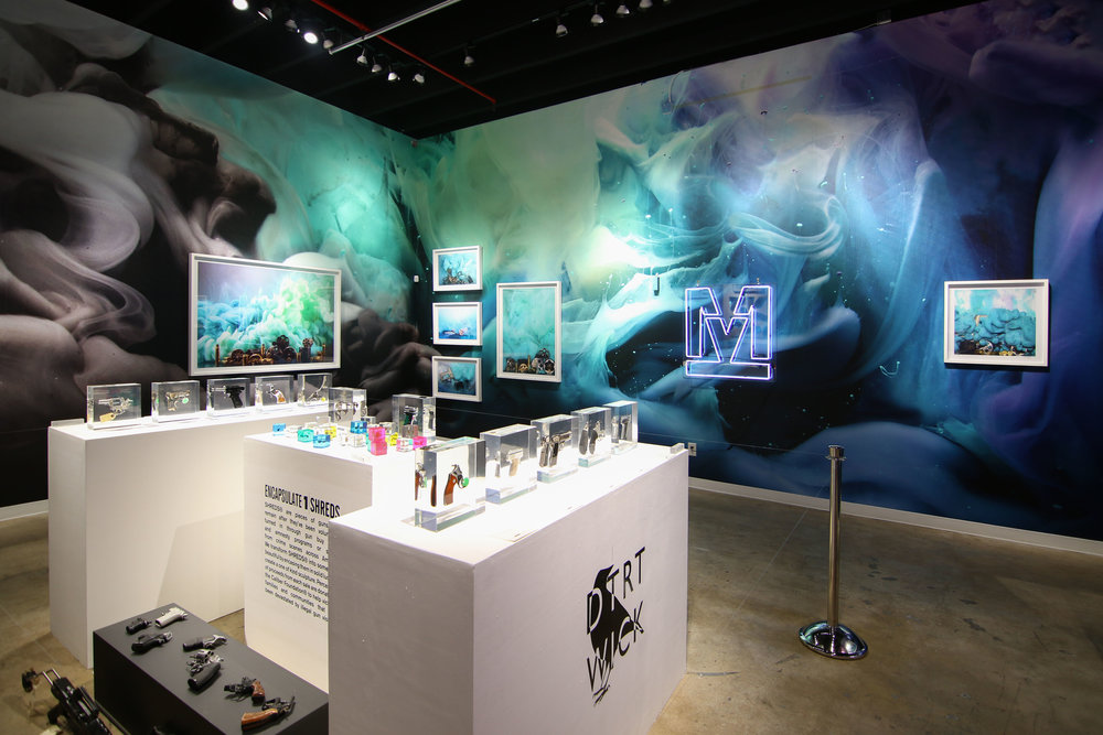 """Black Crow Studios and DetroitWick's #RaiseTheCaliber installation at The Art Plug's """"Mood Swings"""" group show at Oliver Cole Gallery in December 4-10, 2017."""