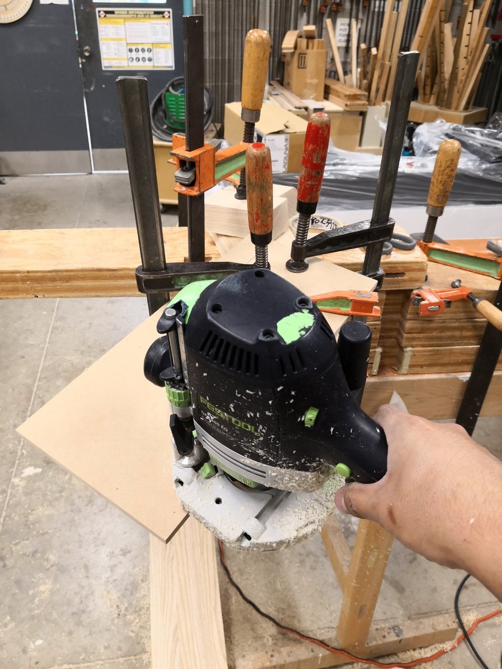 Flush trimming miter edge with template