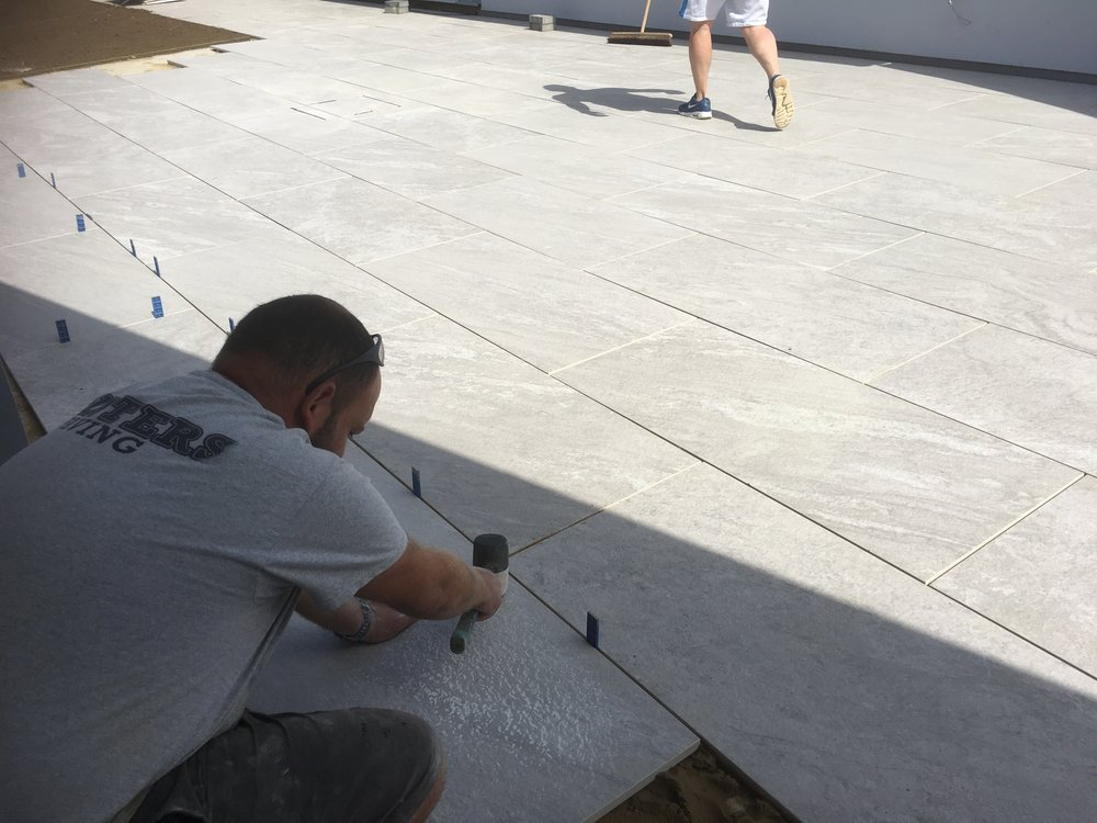 Laying the stunning porcelain paving for this patio, every joint being a specific 5mm joint for pointing.