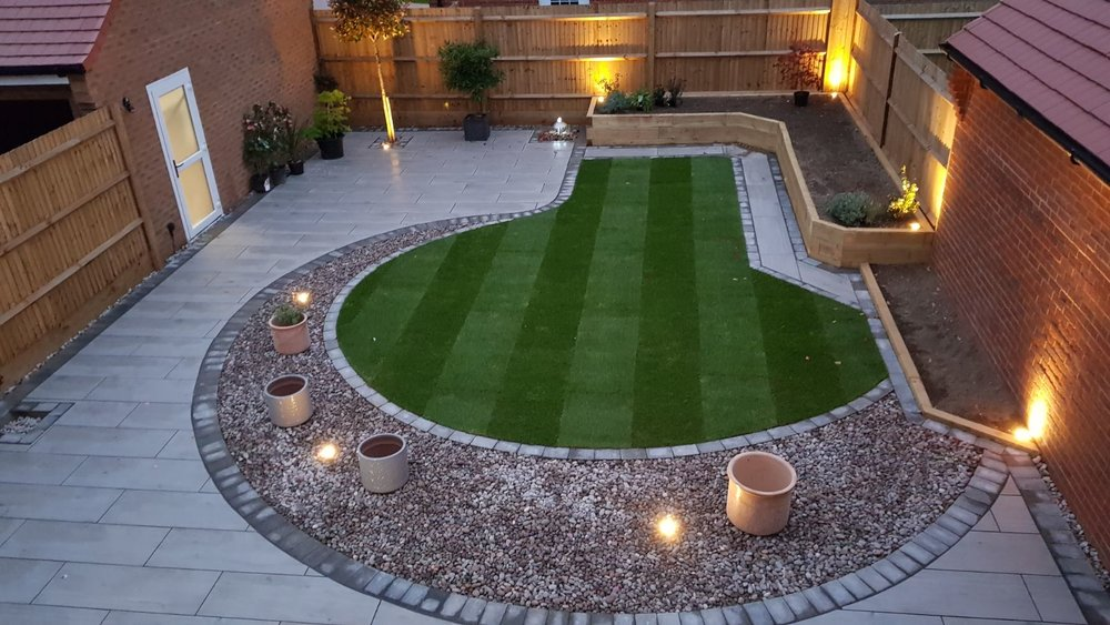A beautiful garden transformation, where we have used porcelain paving, new turf, installed planters with sleepers and also pit lighting all around the garden, this garden was in Felpham Bognor Regis West Sussex.