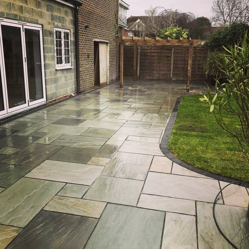 Using Grey Indian sandstone to create this patio area in Worthing West Sussex