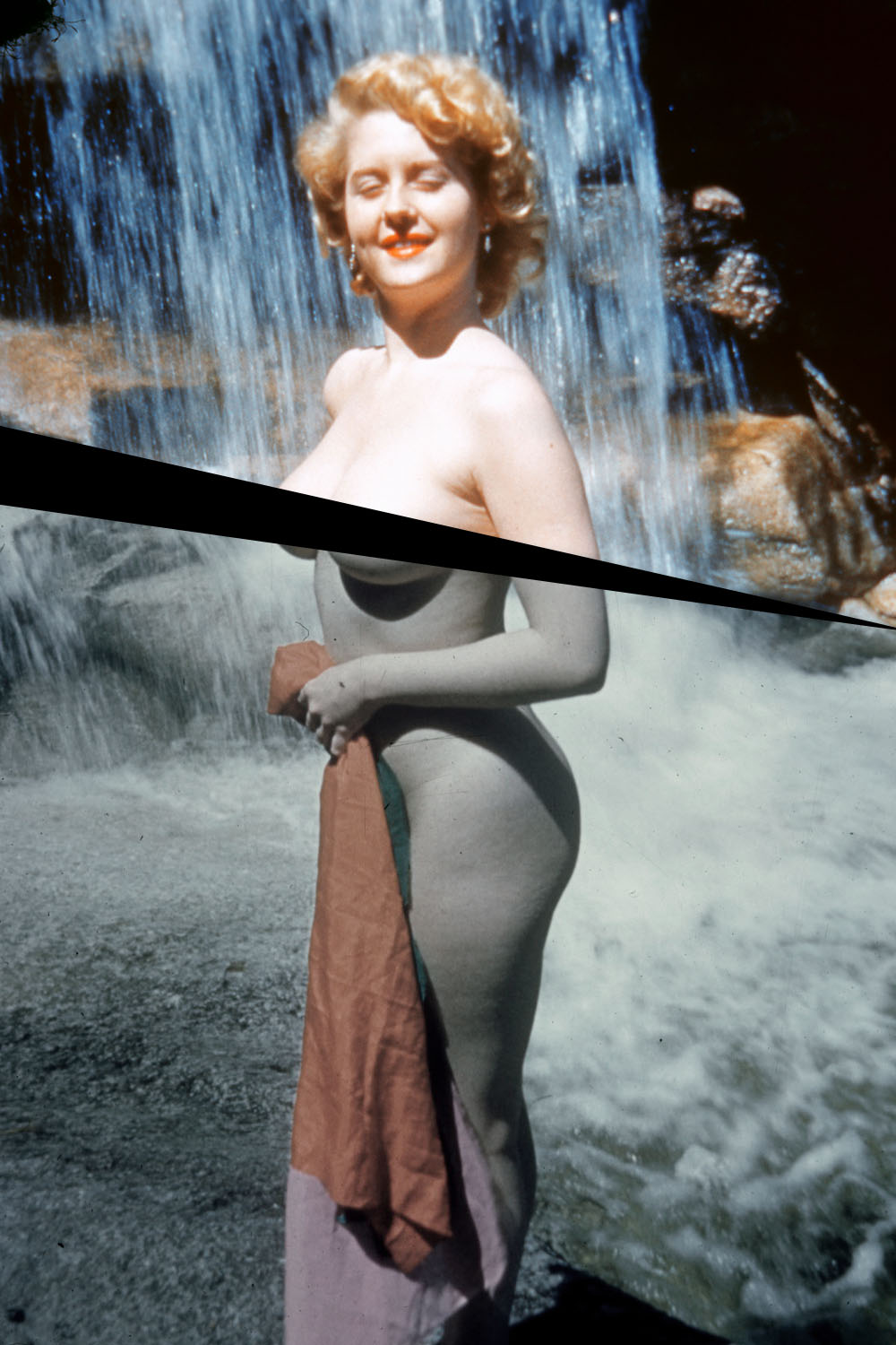 1950s-era woman of a naked woman in front of a waterfall.