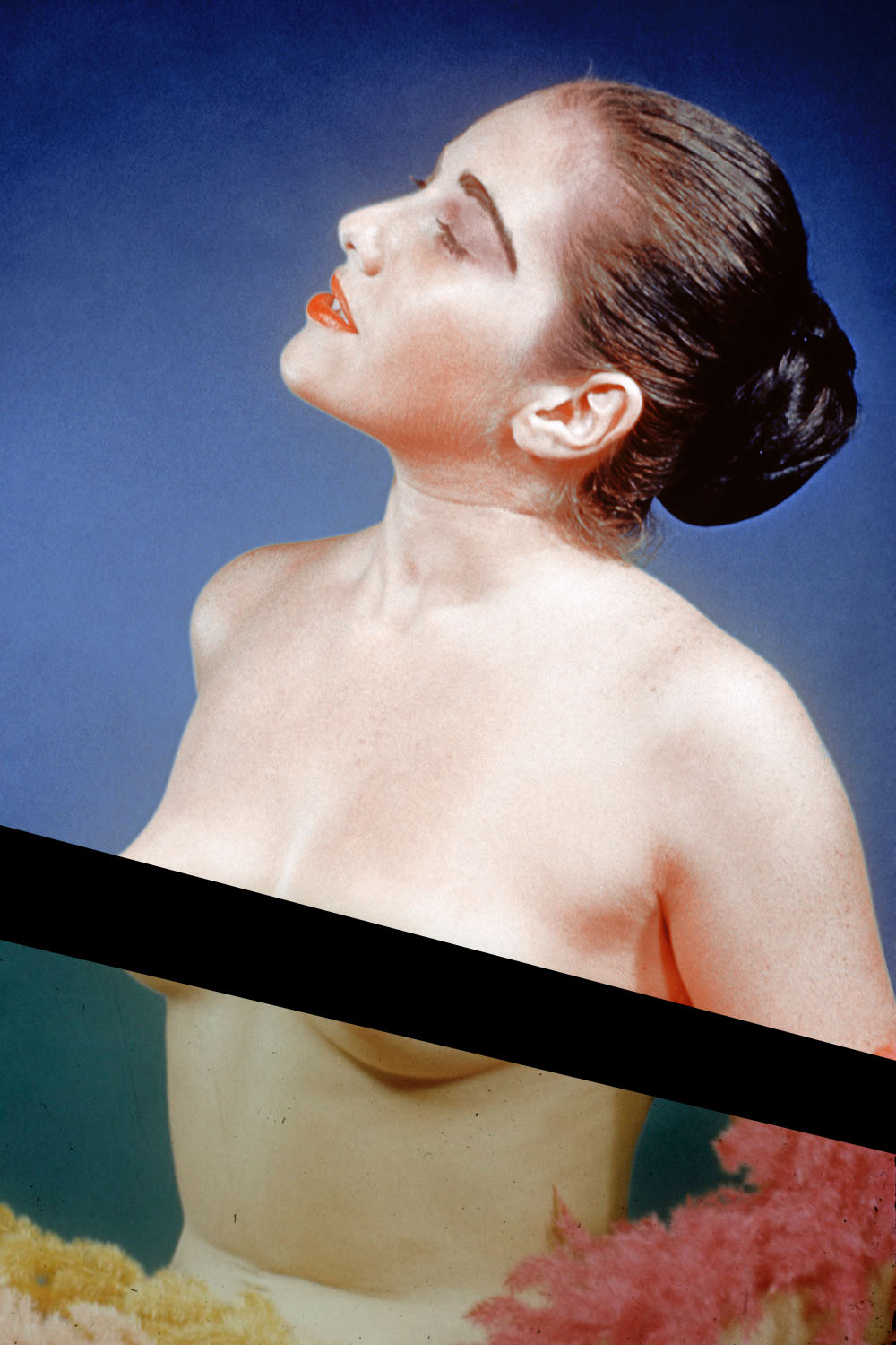 1950s-era pinup of a topless woman posing against a blue background.