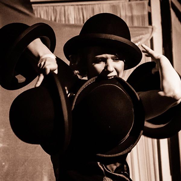 Multi talented circus performer and hat juggler