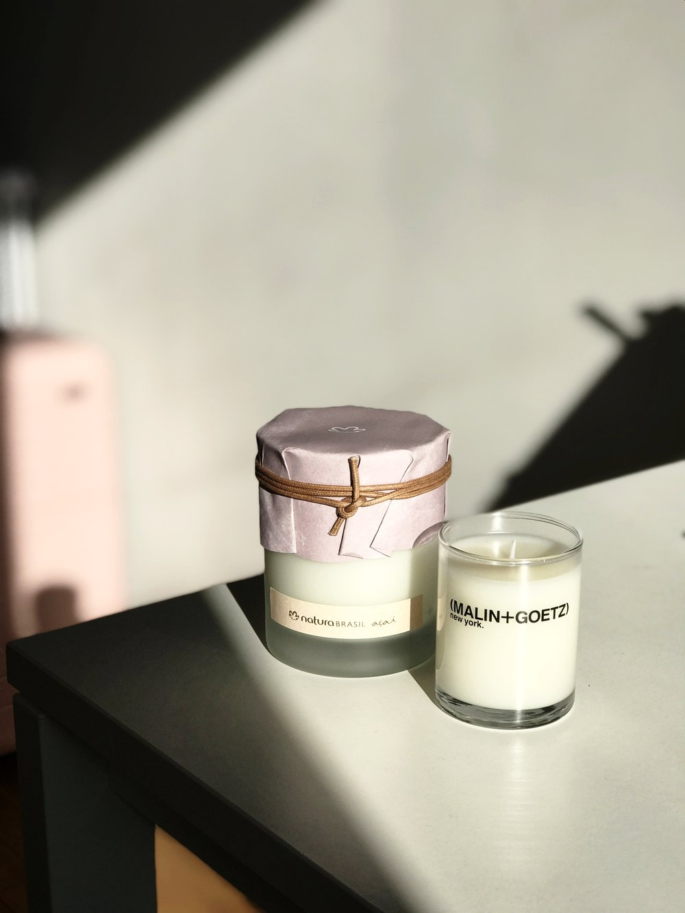 Candles from Natura Brasil and Malin+Goetz.