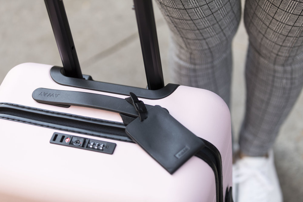 This Away pink suitcase is one of my favorite luggage pieces I've ever owned. Photo by  Ashley Gallerani .