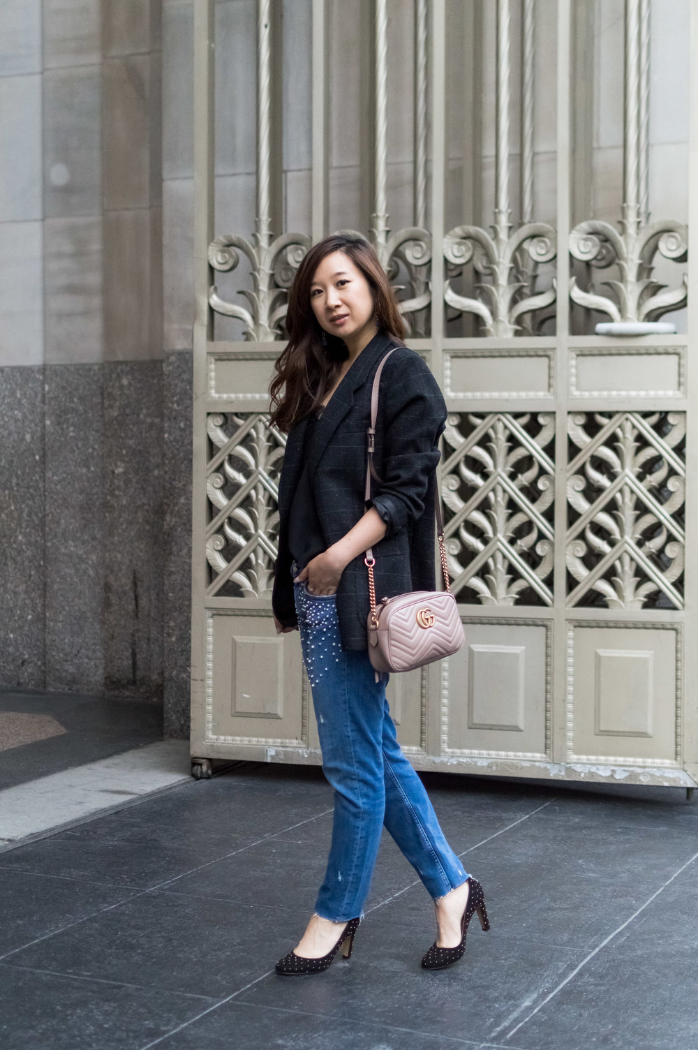 Wearing my grandpa's jacket over pearl jeans. Photo by Tiffany Chen.