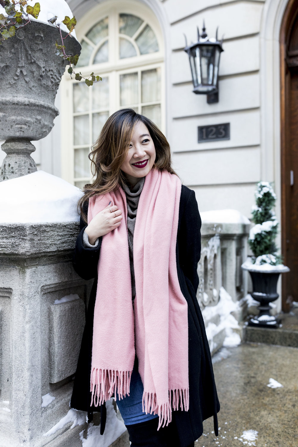 The scarf is from Acne Studios. Photo taken by Ashley Gallerani.