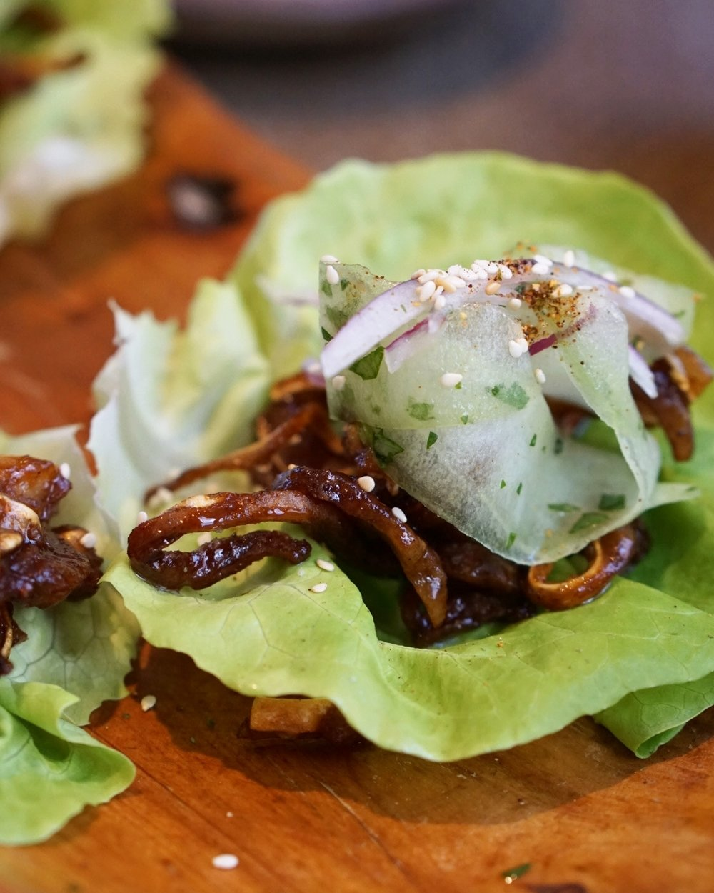 Pig's ear in lettuce wrap, available at Husk.