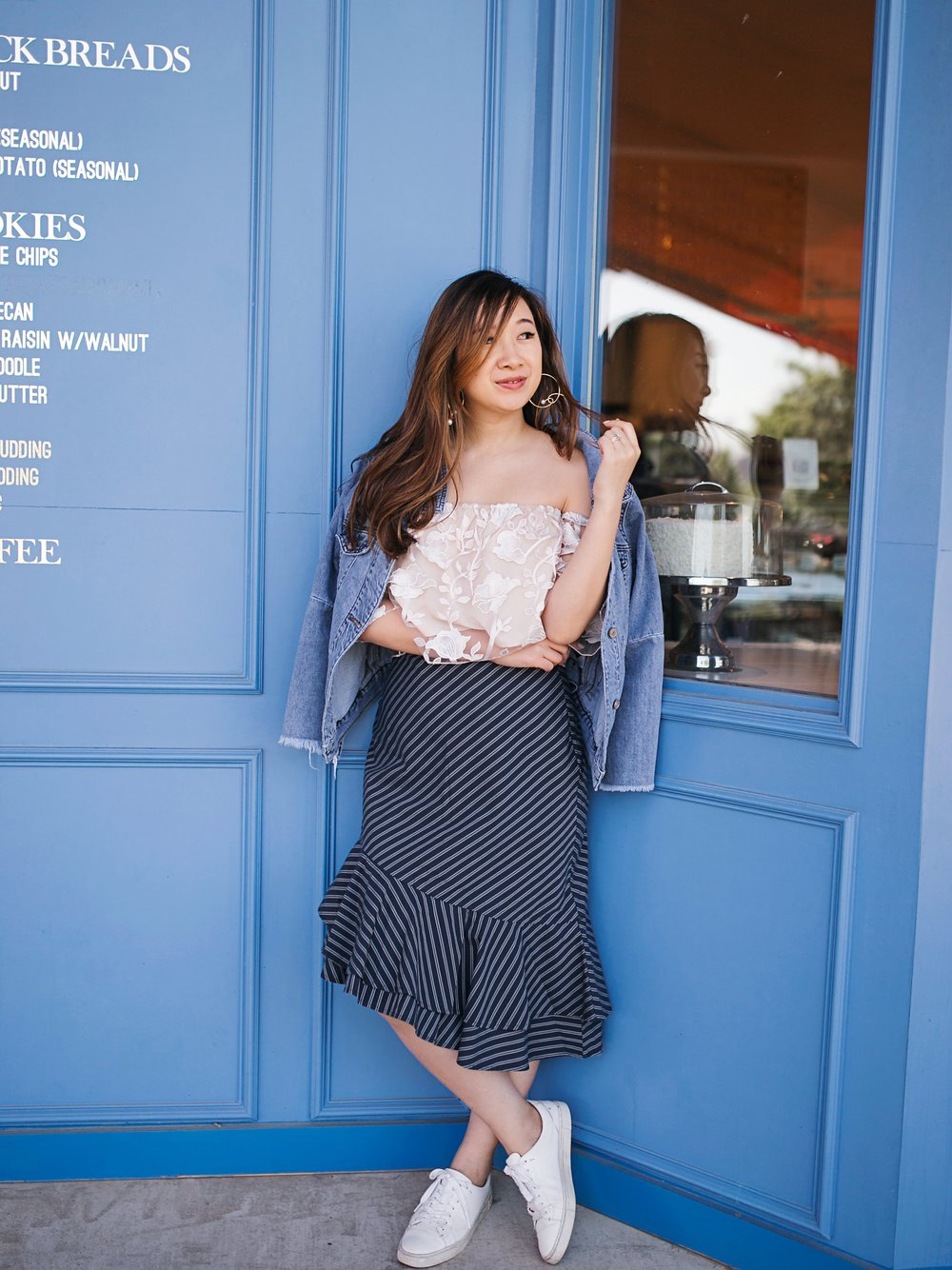 Top from  Tobi ; skirt from  Joie ; sneakers from  Frye . Photo taken by Angie Garcia.