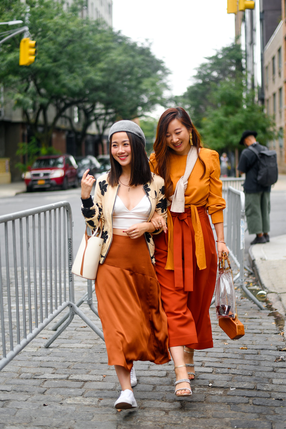 Walking to shows with Lisa Chen from @stylevoila; photographed by  Karya Schanilec