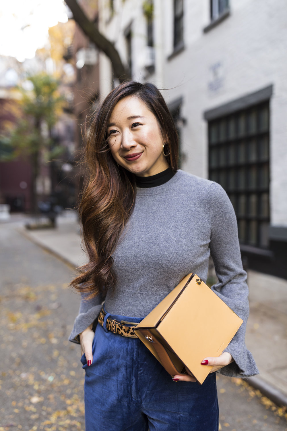 Wearing a grey W. Cashmere sweater. Photo by Ashley Gallerani.