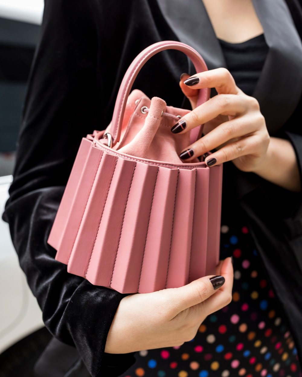 My pink lantern bag is from  mlouye , a bag brand I recently discovered. Nails were done at the non-toxic nail salon called  N Square  in Chelsea. Photo by Ashley Gallerani.