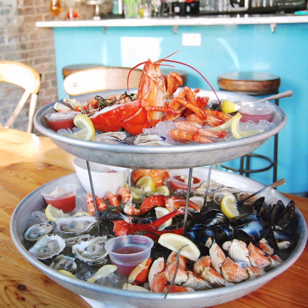 SEAFOOD TOWER This show stopper is a must for any seafood lover. Our tower is brimming with oysters, shrimp, littlenecks, cherrystones, calamari salad, poached mussels, crab legs, lobster & more!