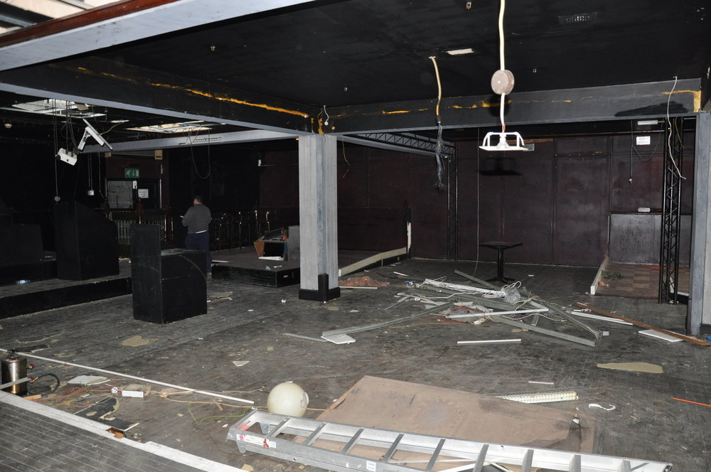 Before   view from what is now the caged vesting room looking onto café to party booths