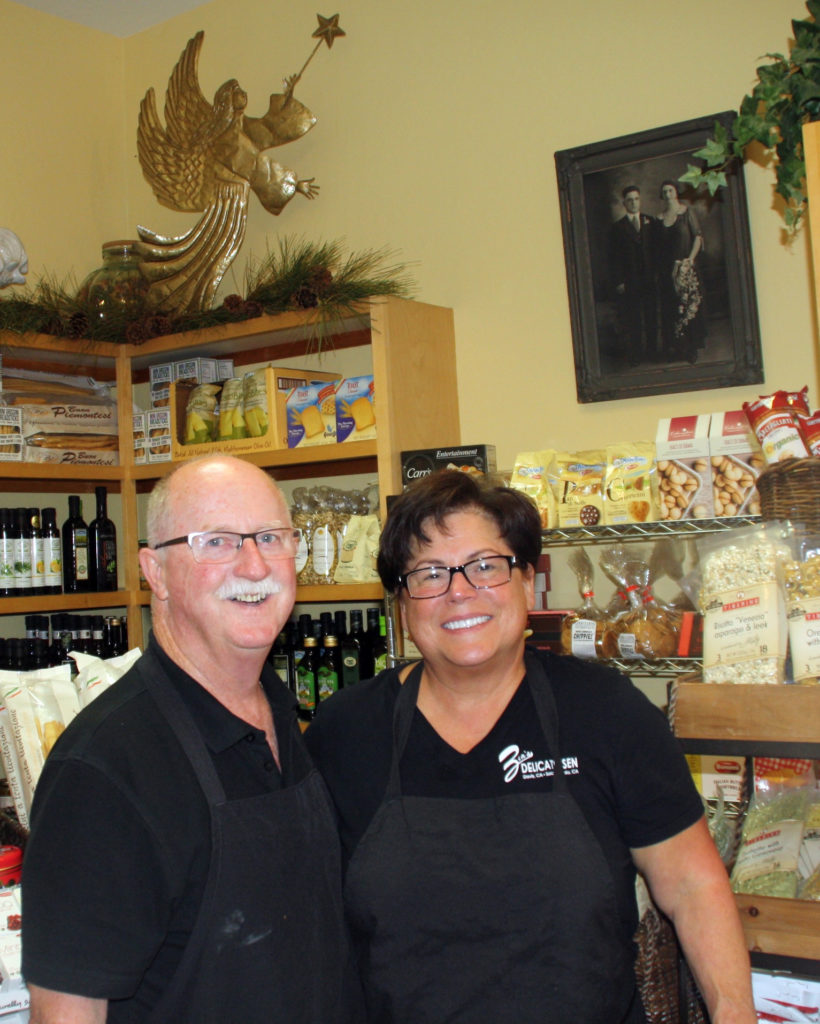 Anne Marie and Kevin Crilly have made Zia's Deli a family affair. Anne Marie's maternal grandparents look down from their portrait on the wall. Bob Schultz/Courtesy photo