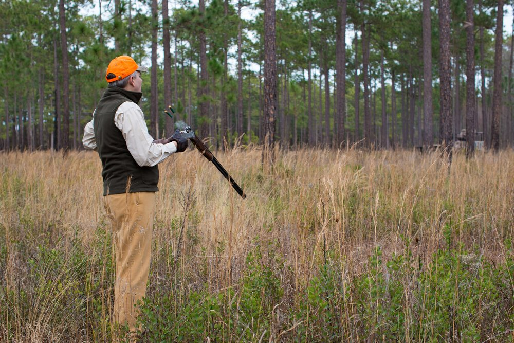 Shadow-Oak-Plantation-Hunter-loading-shotgun.jpg