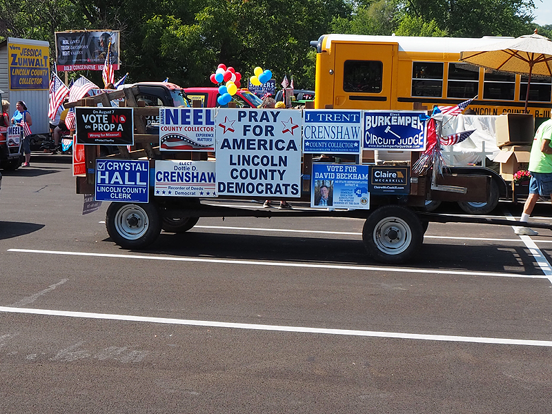 So many good candidates, it took all sides of the float to promote them all.