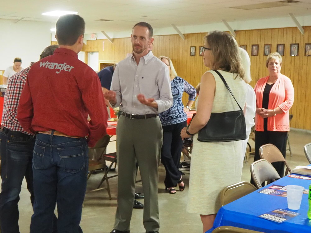 The evening's featured speaker, Missouri Senator, District #1, Scott Sifton, chats with rally attendees.