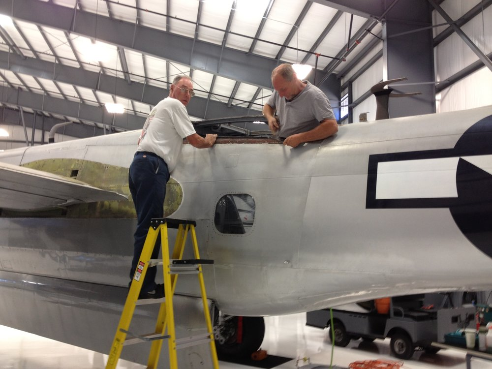 Dale Miller and Dave DeWitt working on the gunner's compartment