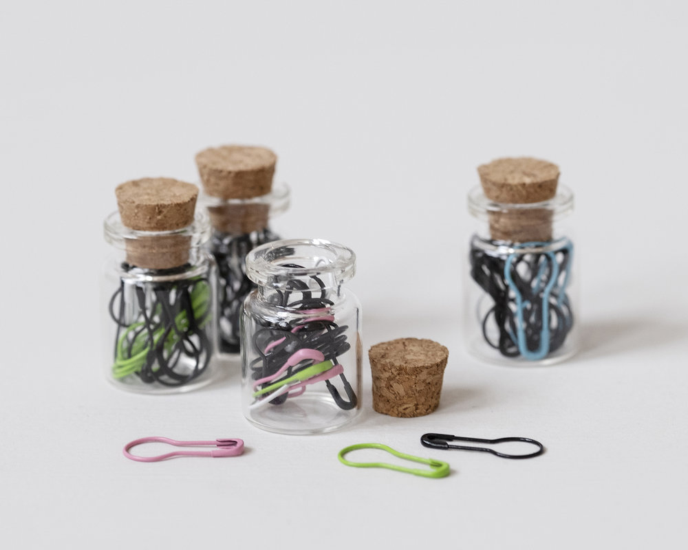 We bottle up  these little cuties  full of multicolored removable stitch markers.