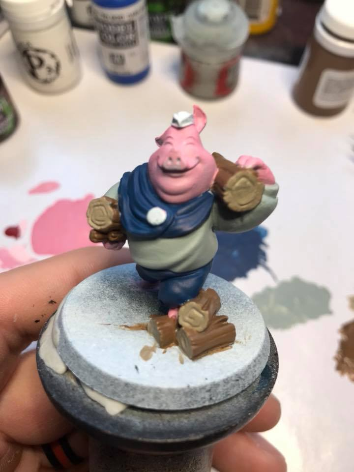 The final step was painting his hat and base green. Use any green you like. The button was painted with Averland Sunset by Citadel.
