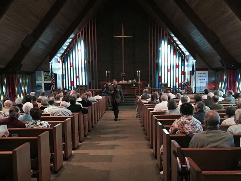 Bishop John Macholz visiting a congregation