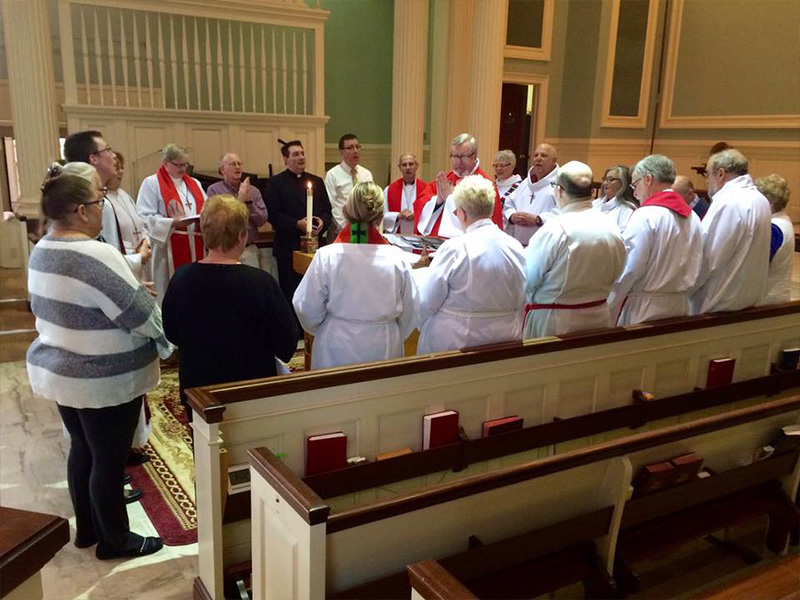 Bishop John Macholz participating in worship