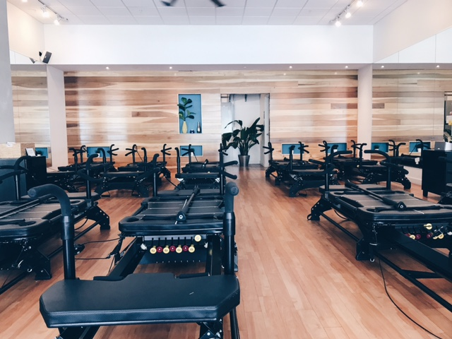 pilates reformer group fitness class at pure pilates