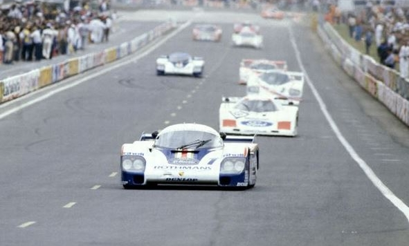 #1 Rothmans Porsche 956 leading down the front straight of Le Mans