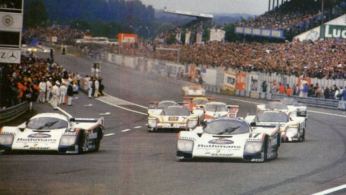 The #17 and #18 Works Porsche 962s leading the field on the Opening lap of The 24 Hours of Le Mans in 1987.