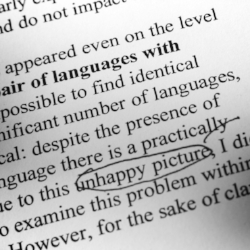 23821511-Proofreading-red-pencil-Stock-Photo-editing-proofreading-proofread.jpg