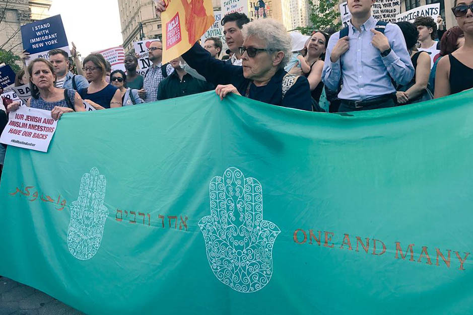 JFREJ members rallying against Islamophobia and the Muslim Ban in June 2018
